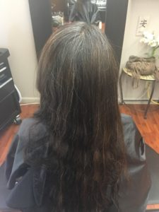 Long dark hair in back before style